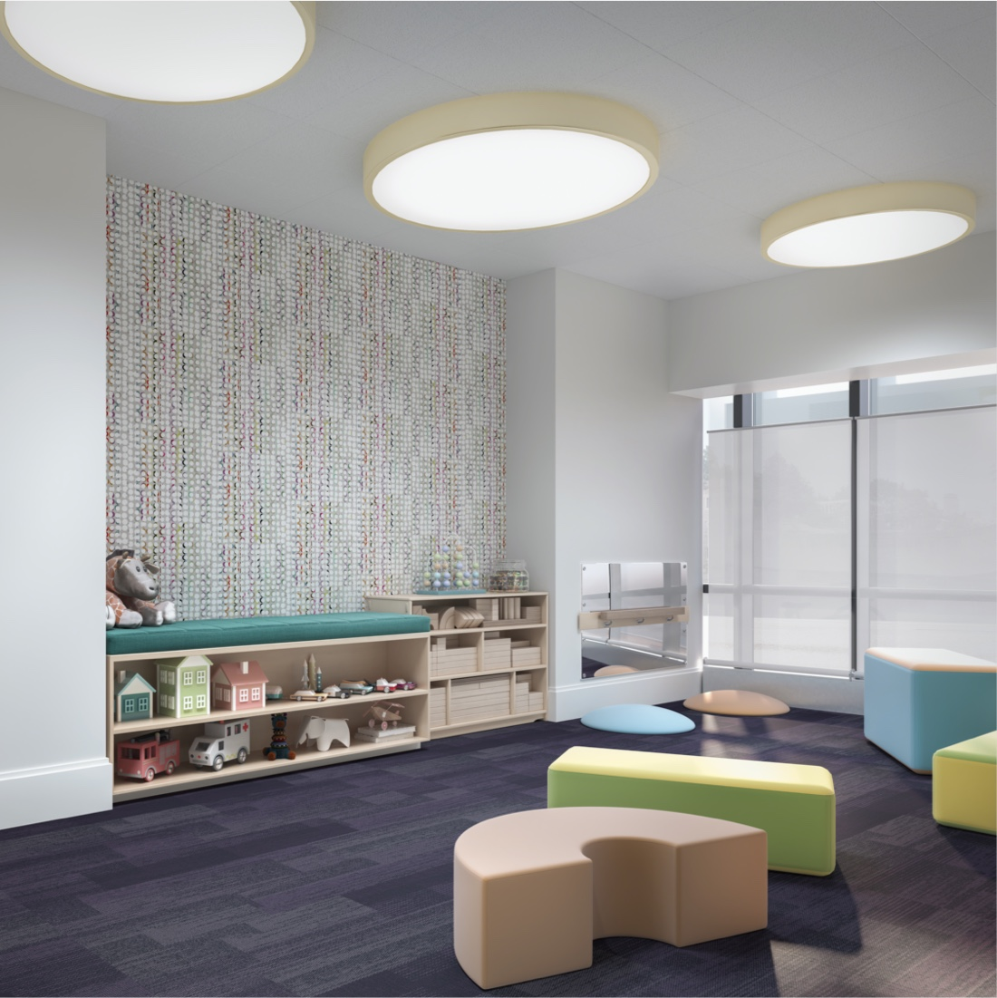 Kids playroom area with colorful seating blocks and toys