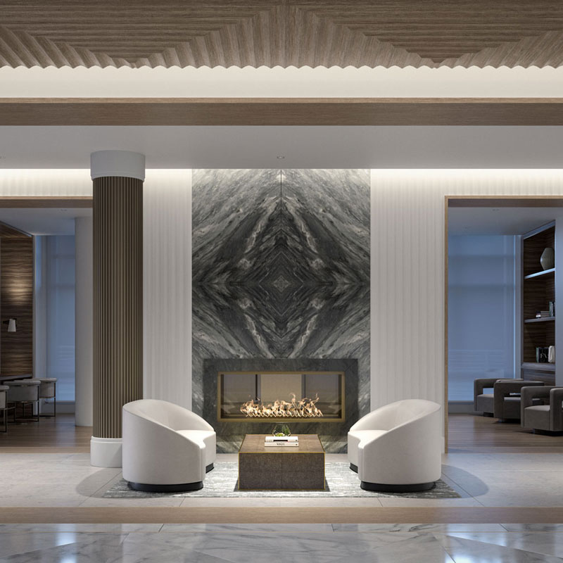 100 Shawmut's white marble lobby with brass pillar, glass fireplace, and various seating options