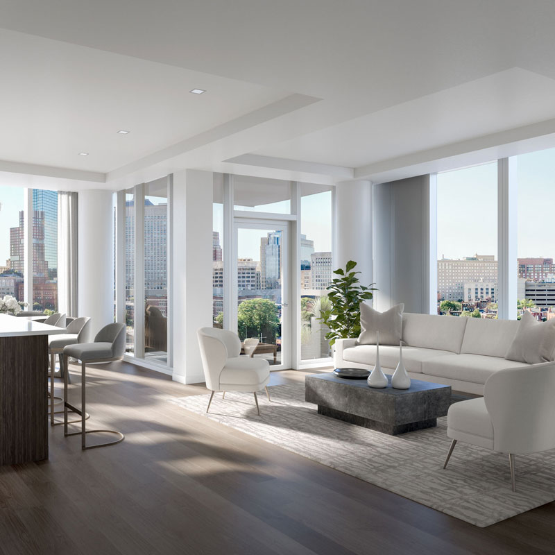 100 Shawmut unit living room with wood floors and light colored furniture overlooking downtown Boston