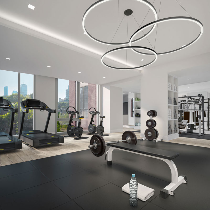 100 Shawmut's fitness room with city views of downtown Boston
